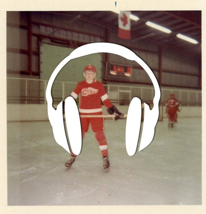 Old photograph of a boy wearing red hockey gear with a symbol of headphones overlaying the picture