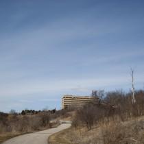 A park path leading to a hospital.