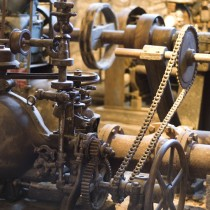A chain linking metal gears and machinery.